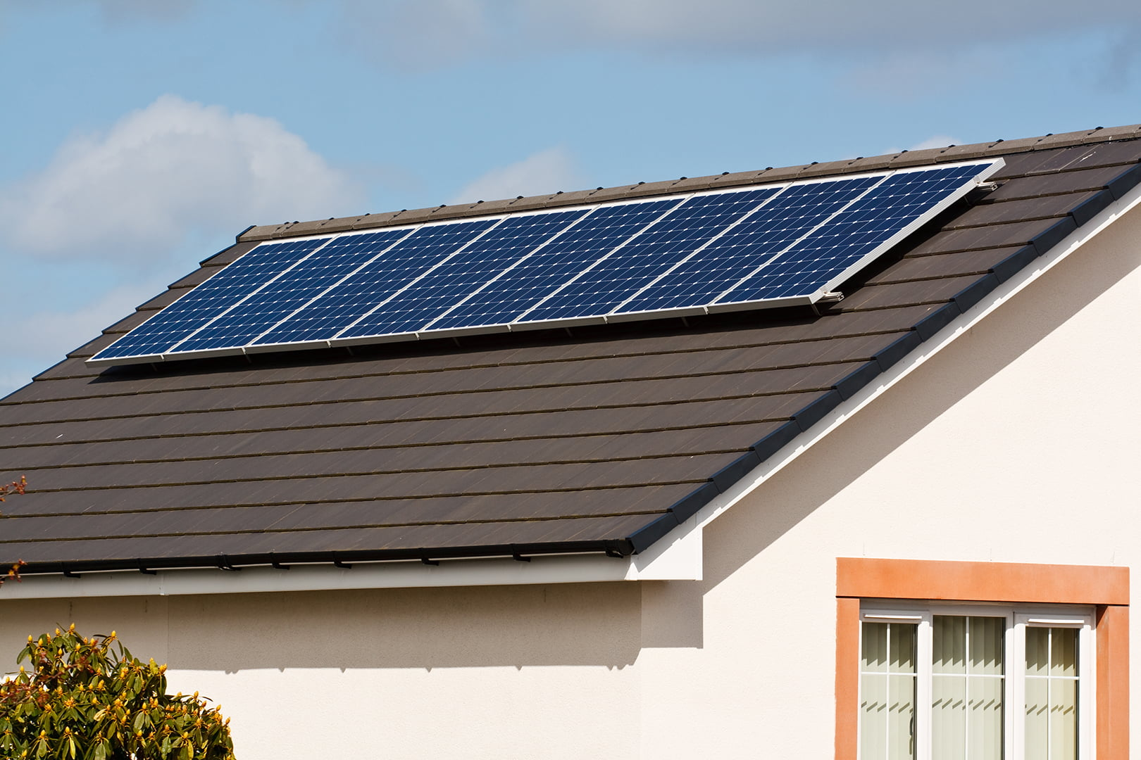Photovoltaic Solar Energy panels Mounted on a new tile roof