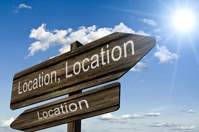 Sign saying Location, Location, Location
