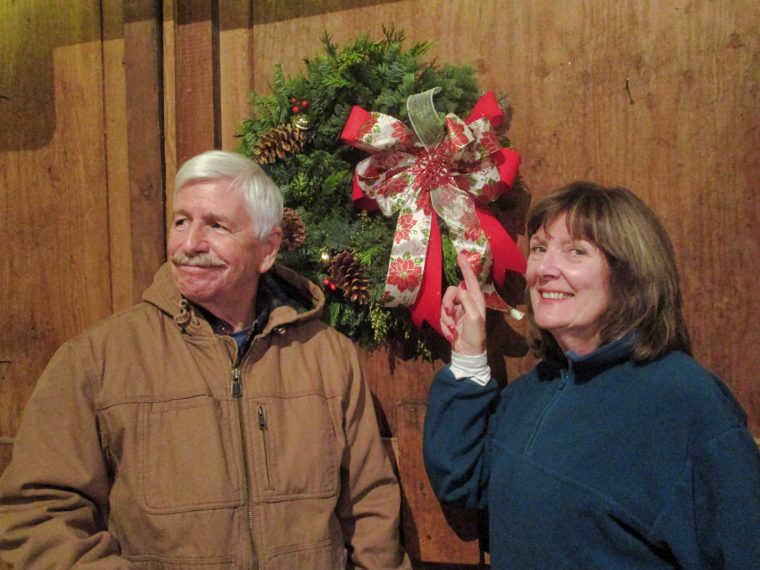 Ken and Libby Guthrie with their finished Christmas wreath