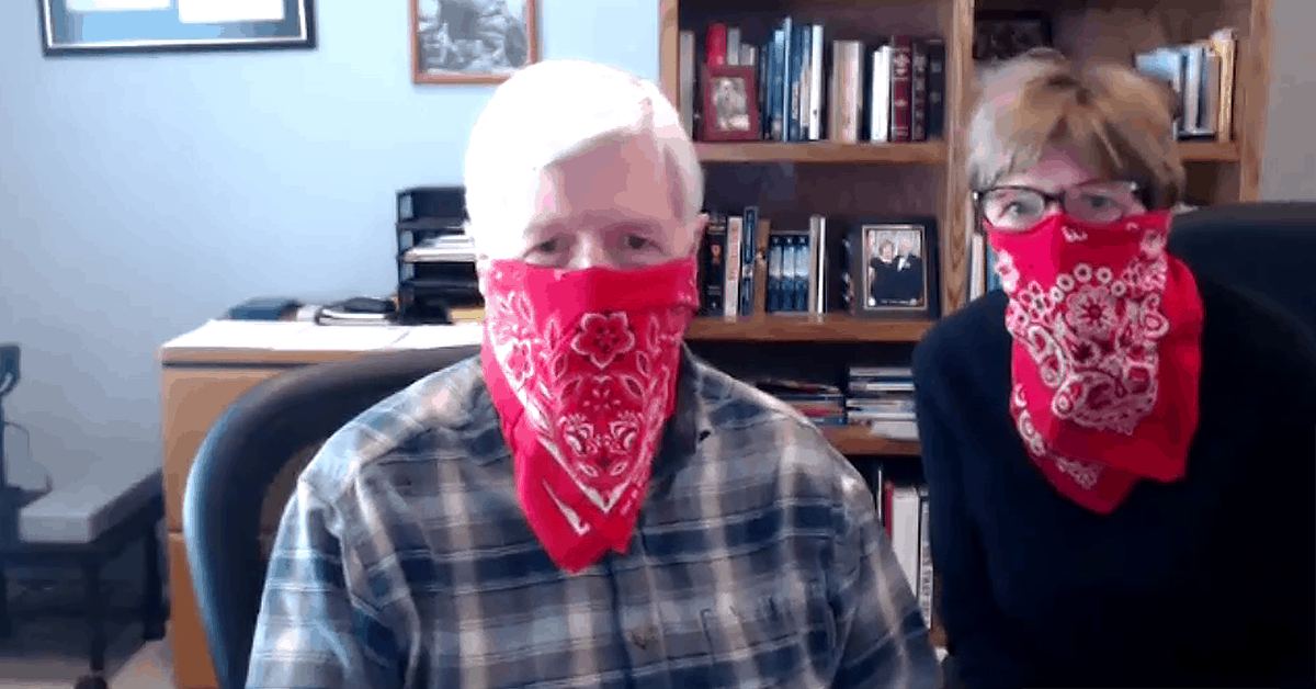 Ken and Libby Guthrie wearing cowboy bandanas over their faces